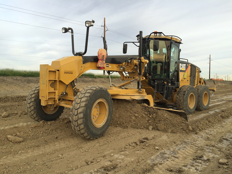 southern alberta road construction excavator rock truck