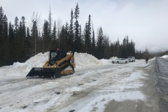 Rubydale cat for asphalt paving job in Banff National Park near Mistaya Canyon