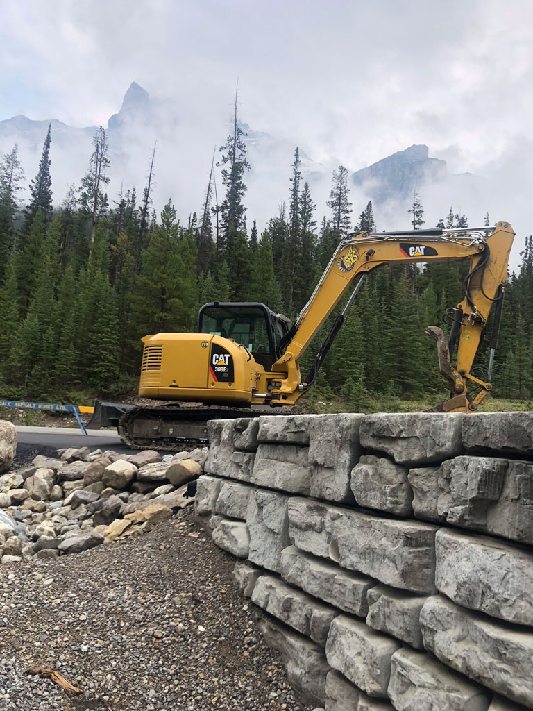 Rubydale Building A Retaining Wall At Mistaya Canyon, Alberta.